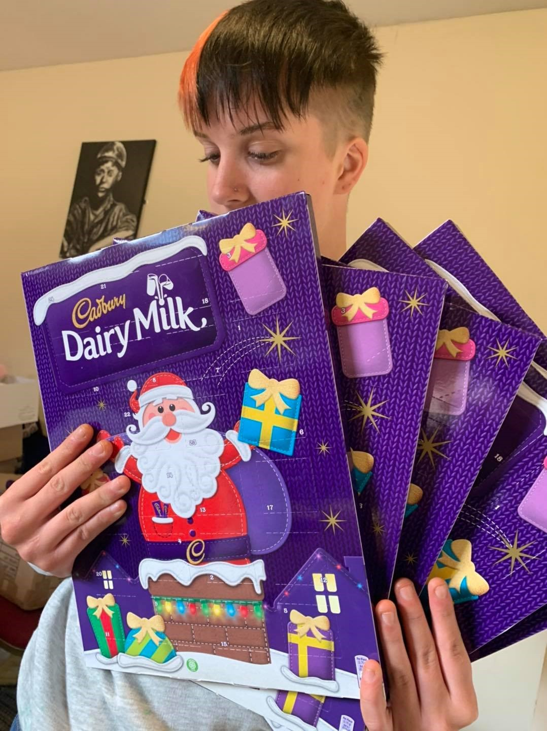 Courtney Ashe, DurhamWorks participant handing out advent calendars to the vulnerable.