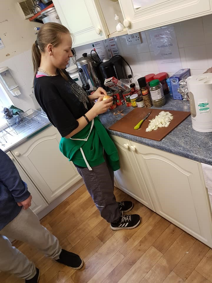 Paula Palmer preparing meals in the kitchen